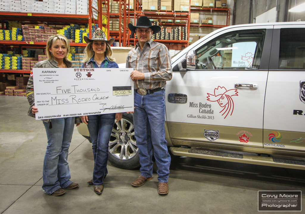 Miss Rodeo Canada program coordinator Jocelyne Lambert, Miss Rodeo Canada Gillian Sheilds, and Jim Nevada from Roper pose with a cheque for $5,000 which will go towards the Miss Rodeo Canada program. The funds were raised from a Warehouse Sale held at Roper in Airdrie April 6.