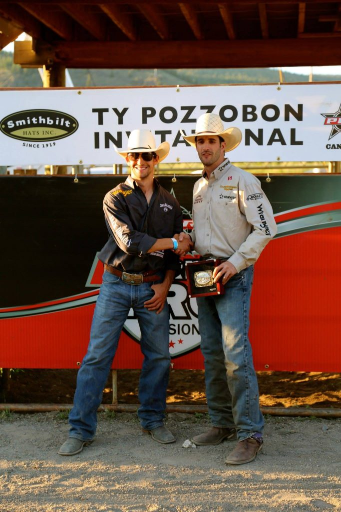 Ty Pozzobon presents Aaron Roy with the Montana Silversmiths buckle for winning the third annual Ty Pozzobon Invitational PBR in Merritt, BC on May 30th, 2015. Photo by Gail Joe.
