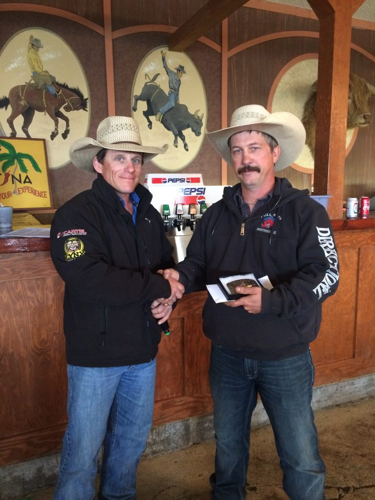 Russell Friend presents Ken McGinnis with the championship Jensen Silver trophy buckle at the Seventh Annual Friend Futurity on May 14th, 2015.